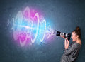 Photographer girl making photos with powerful light beam young Stock Images