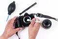 Photographer hand cleaning sensor of camera by using sensor swab