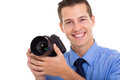 Photographer holding camera cheerful a dslr isolated on white Royalty Free Stock Image