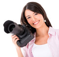 Photographer holding a digital camera professional isolated over white Royalty Free Stock Image