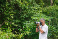 Photographer in the jungle Royalty Free Stock Photo