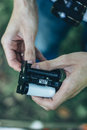 Photographer loading medium format film into the film back Royalty Free Stock Photo