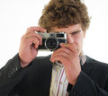 Photographer from mm the camera young old on a light background Royalty Free Stock Image