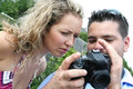 Photographer and model checking photos on camera Royalty Free Stock Photography
