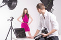 Photographer and model holding camera looking at fashion Stock Photography
