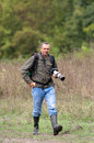 Photographer in nature with telephoto camera walking Stock Photo