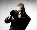 Photographer professional in a suit with a camera Royalty Free Stock Images