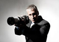 Photographer professional in a suit with a camera Royalty Free Stock Photos