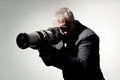 Photographer professional in a suit with a camera Royalty Free Stock Image