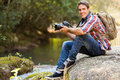 Photographer resting mountain handsome young in valley Stock Photography