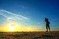 Photographer shooting near the beach when sun rising silhouette Royalty Free Stock Photos