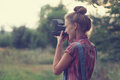 Photographer shooting outdoors girl at sunset Royalty Free Stock Photos