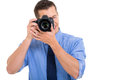 Photographer shooting pictures male on white background Royalty Free Stock Images