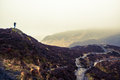 Photographer silhouette on a scottish mountain in a cloudy day the top of ben an Stock Photo