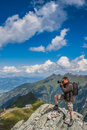 Photographer takes pictures in the mountains taking on rocks alps austria Stock Image