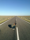 Photographer taking photo on outback road hubby snaps a pic of me as i shoot the empty with my big camera Stock Image