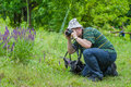 Photographer taking a photo of wild butterfly Royalty Free Stock Photo