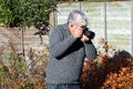 Photographer taking photograph pointing right a a and to the in the image Royalty Free Stock Photos