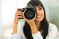 Photographer taking photos close up portrait of female with digital camera Royalty Free Stock Photo