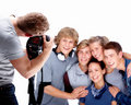 Photographer  taking picture of teen models Stock Images