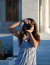 Photographer tourist takes pictures Stock Photography