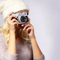 Photographer unrecognizable woman taking photo with film camera blonde young vintage in studio Stock Image