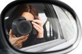 Photographer using his professional camera girl in the car window mobile reporter with the dslr Royalty Free Stock Photography