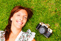 Photographer a woman on the grass Royalty Free Stock Photo