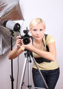 Photographer, young beautiful girl with camera Royalty Free Stock Photo
