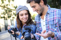 Photographers making reportage in city Royalty Free Stock Photo