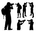 Photographers silhouettes with telephoto lens Royalty Free Stock Photo