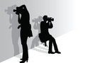 Photographers at work vector silhouette illustration of two based on a photo i took and freehand Royalty Free Stock Image