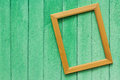 Photographic frame on the wall hanging wooden street Stock Photos