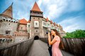 Photographing corvin castle female tourist with professional photo camera tourism in romania european country Royalty Free Stock Images