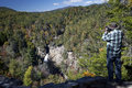 Photographing linville falls on the blue ridge par this is an image of a photographer taking a photo of parkway in north carolina Stock Photo