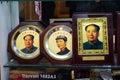 Photographs of Chairman Mao Zedong in shop window of shopping area of Wangfujing in Beijing Royalty Free Stock Photo