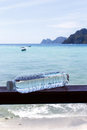 Photography of bottles against sea