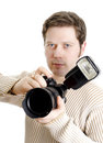 Photojournalist holding camera Royalty Free Stock Image