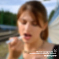 Photorealistic background with blurred face of a girl manicure Royalty Free Stock Image