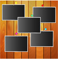 Photos attached stationery pins to wooden wall Stock Photo