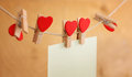 Photos and a heart hanging on clothespin Stock Photography