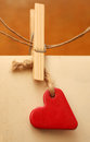 Photos and a heart hanging on clothespin Stock Photo