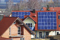 Photovoltaic electricity generation with solar panels on the roof Royalty Free Stock Photo