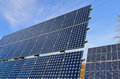 Photovoltaic panels fitted in series on roof Stock Image