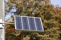 Photovoltaic solar panel on leaves background Stock Image