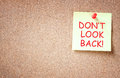 The phrase don't look back written on sticky note. room for text Royalty Free Stock Photo