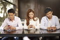 Phubbing young people playing with smartphones and ignoring each other Royalty Free Stock Photo