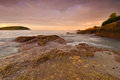 Phuket beach at sunrise with interesting rocks in foreground thailand Royalty Free Stock Image
