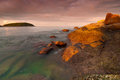 Phuket beach at sunrise with interesting rocks in foreground thailand Royalty Free Stock Photo