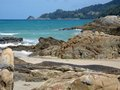 Phuket island coastline rocky outcrops and sand make up this craggy shoreline on the of Royalty Free Stock Photos